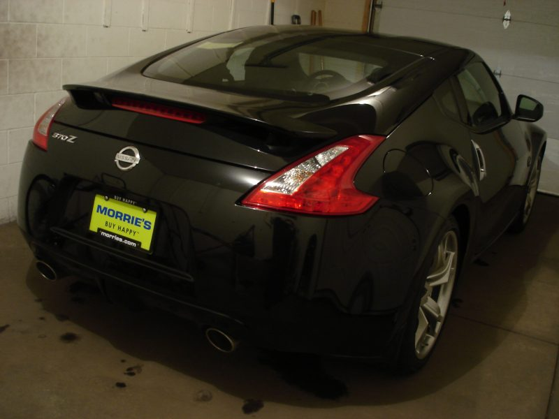 My Z arrived on 4-14-2011. Went to the dealership today, 4-15-2011, signed the papers, and brought it home. It was raining/snowing outside so I had to park it in the garage and wipe down the rain/snow water. I could only photograph the rear as there wasn't enough room in the front to take a photo.