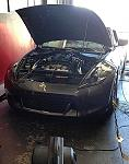 Car on the dyno at Specialty Z for Fast Intentions twin turbo tune.