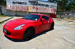 Red 370z with flat black Varrstoen wheels.