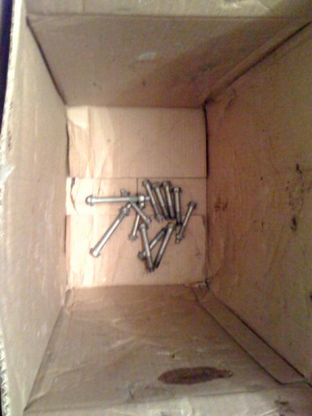 Bolts just tossed into the bottom of the box.