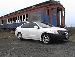 My Altima up state by some old trains.