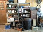 Garage02. Coleman gear and misc. Filing cabinet has two drawerfuls of lamps - from 3W Christmas tree size up 500W halogen. For interior lighting,...