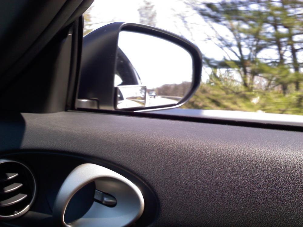 Passenger side convex mirror.  This is one of the three things you can do to eliminate the dreaded blind spot.